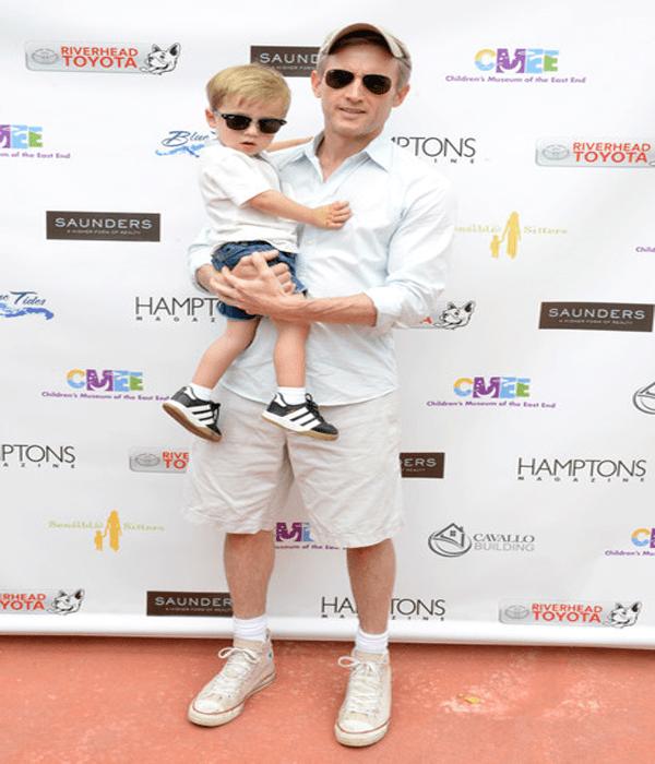 Dan Abrams and his son at family fair