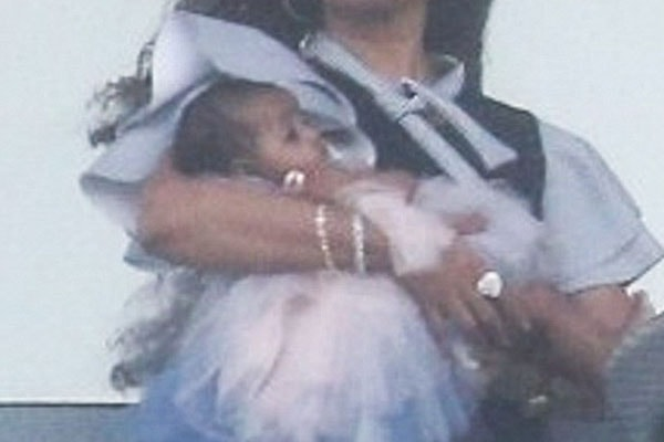 Cardi B Poses for a picture with her daughter Kulture Kiari Cephus in Miami balcony