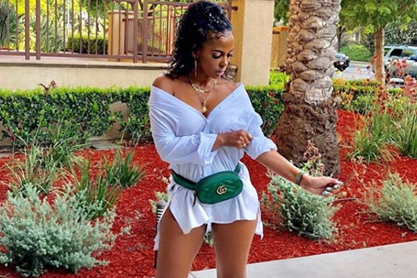 Sundy Carter posing with her Gucci bag and branded clothes