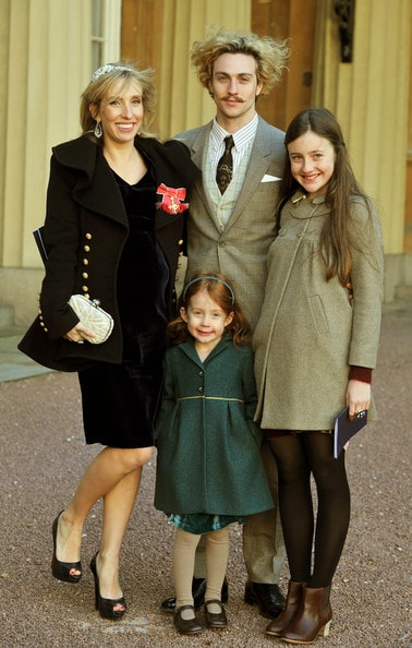 Sam Taylor-Johnson with her daughters and husband to receive an OBE.