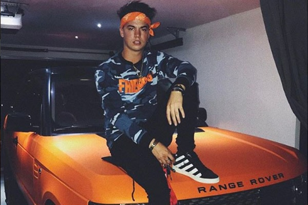 Taylor Caniff posing with his Range Rover.