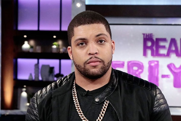 O'Shea Jackson with his gold chain on, and his net worth
