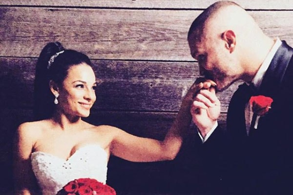Randy Orton's wife Kim Marie Kessler and him during their wedding