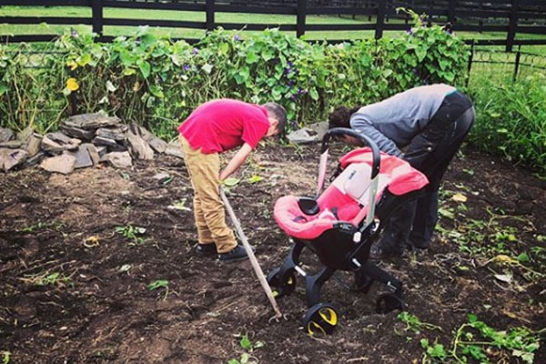 Augustus working in garden with mother Hilarie