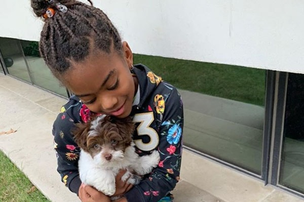 Camryn Paul with her dog