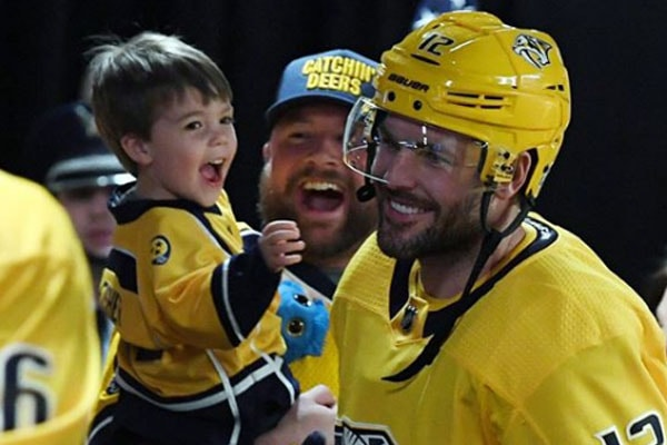 Mike Fisher with son Isaiah Michael Fisher in his game