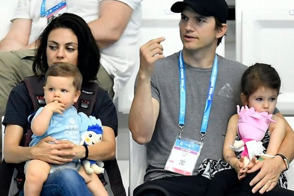 Mila Kunis and Ahston Kutcher with their two children