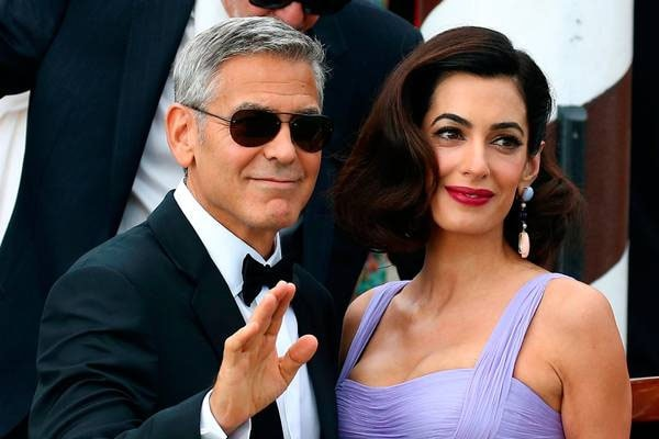 George Clooney with his wife Amal.