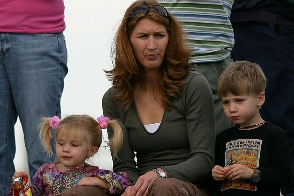 Jaz Agassi watches her father's match with mother Steffi Graf and brother Jaden Agassi