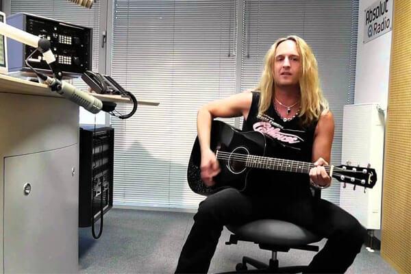 Julian Angel Vai playing guitar