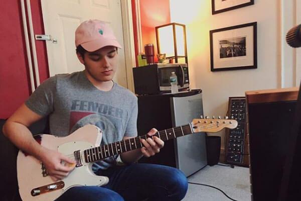 Dante Palminteri playing guitar