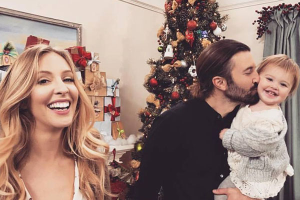 Eva James with her father Brandon Jenner and mother Leah Feder