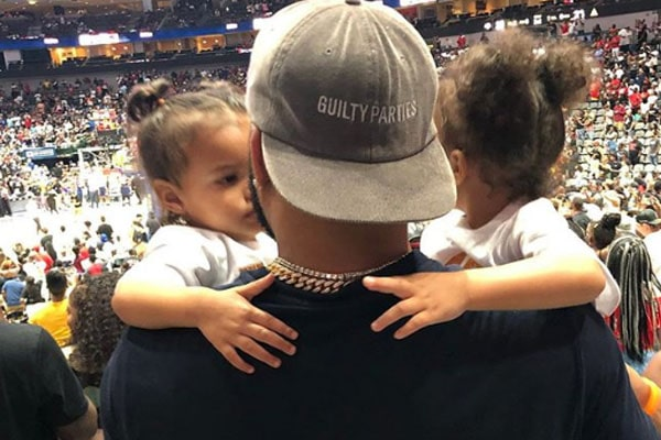 Andre Emmett with daughters