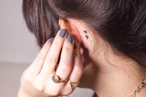 Molly Burke's behind the ear tattoo